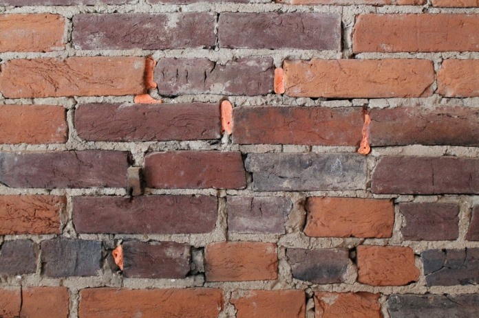 how to chip plaster off brick